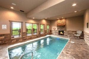 indoor pool with a fire place